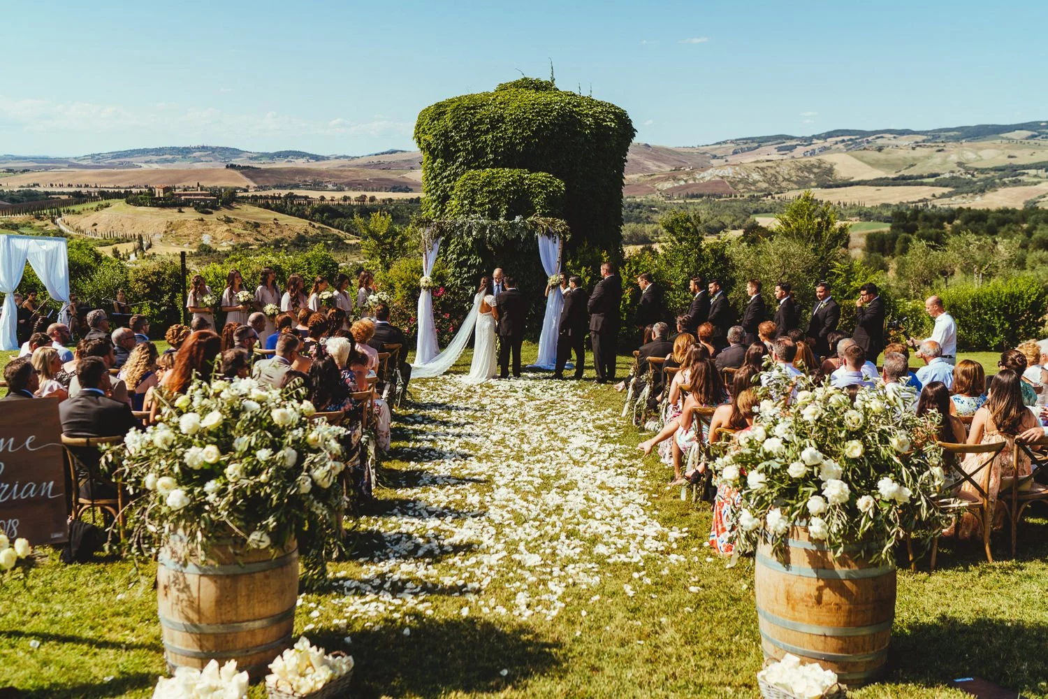 A bride and groom being married at a popular wedding venue in Italy, Borgo Di Castelvecchio, while Magic Wedding Photographer captures the moment.