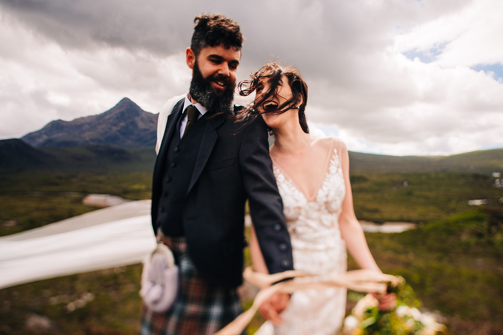 bride and groom celebrating their wedding day on the Isle of Sky photographed by Magic Wedding Photographer