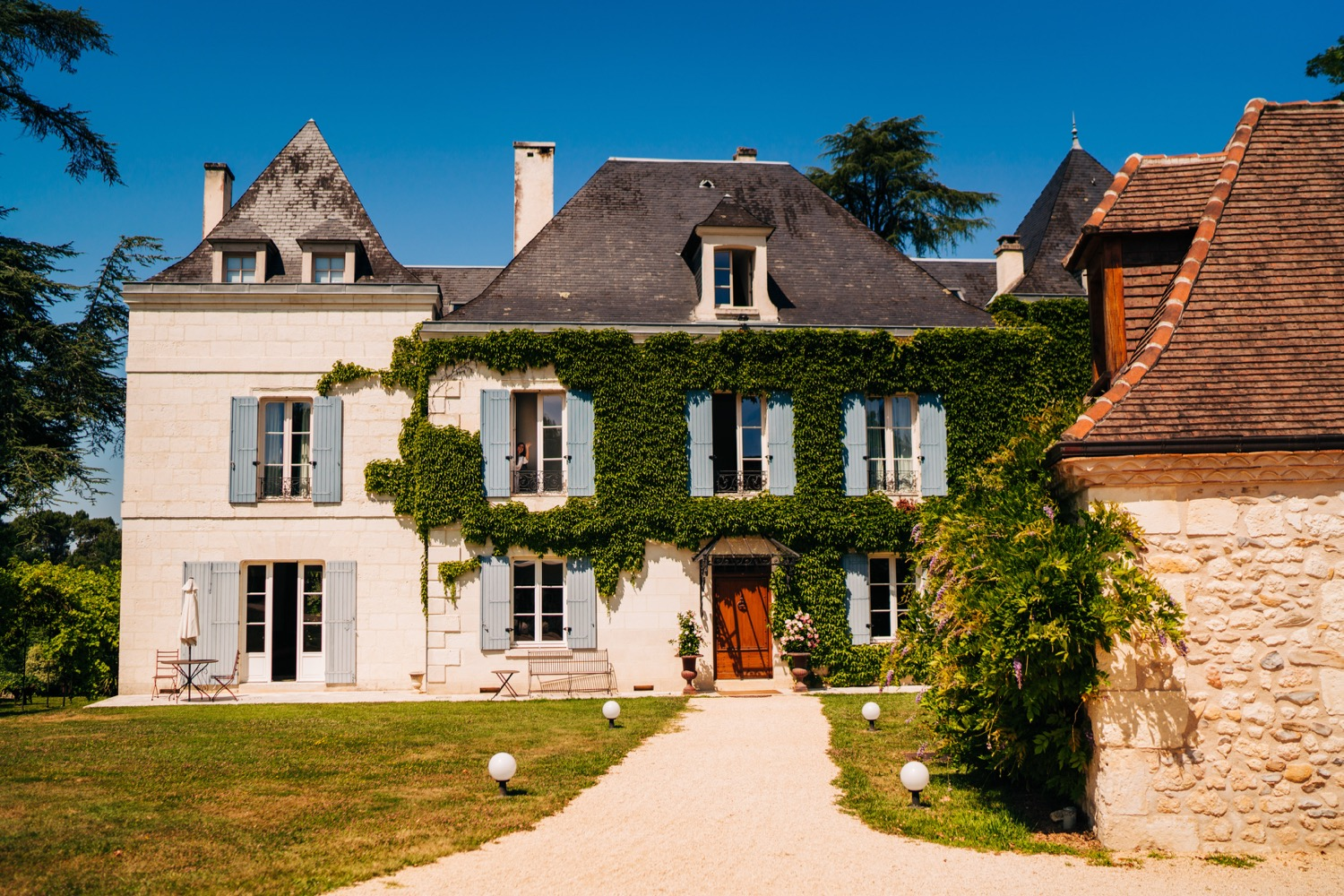 A beautiful mansion covered in vines at Domaine La Fauconnie wedding venue in South France.