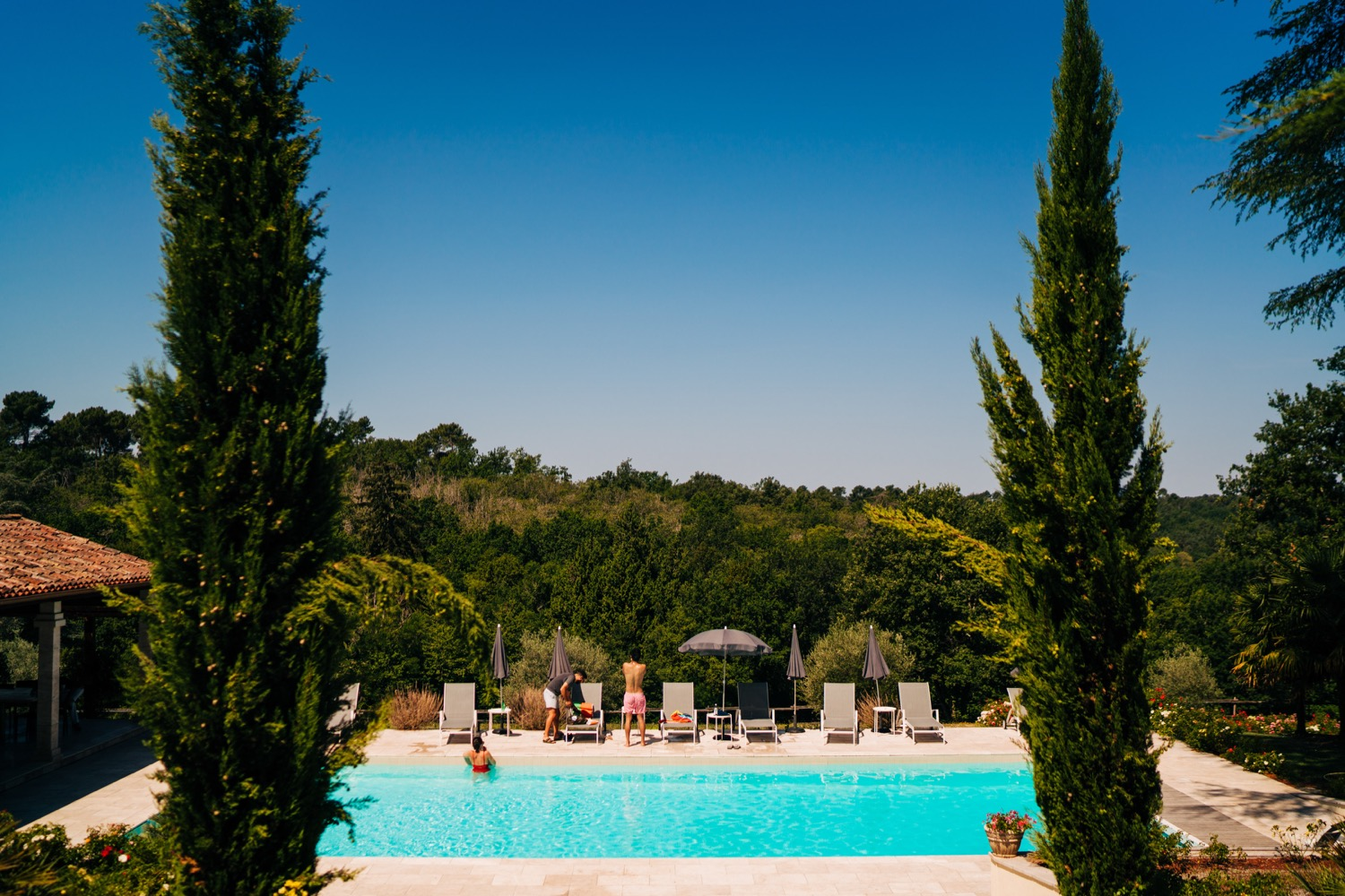 An outdoor pool with a beautiful view at a popular European wedding venue Domaine La Fauconnie.