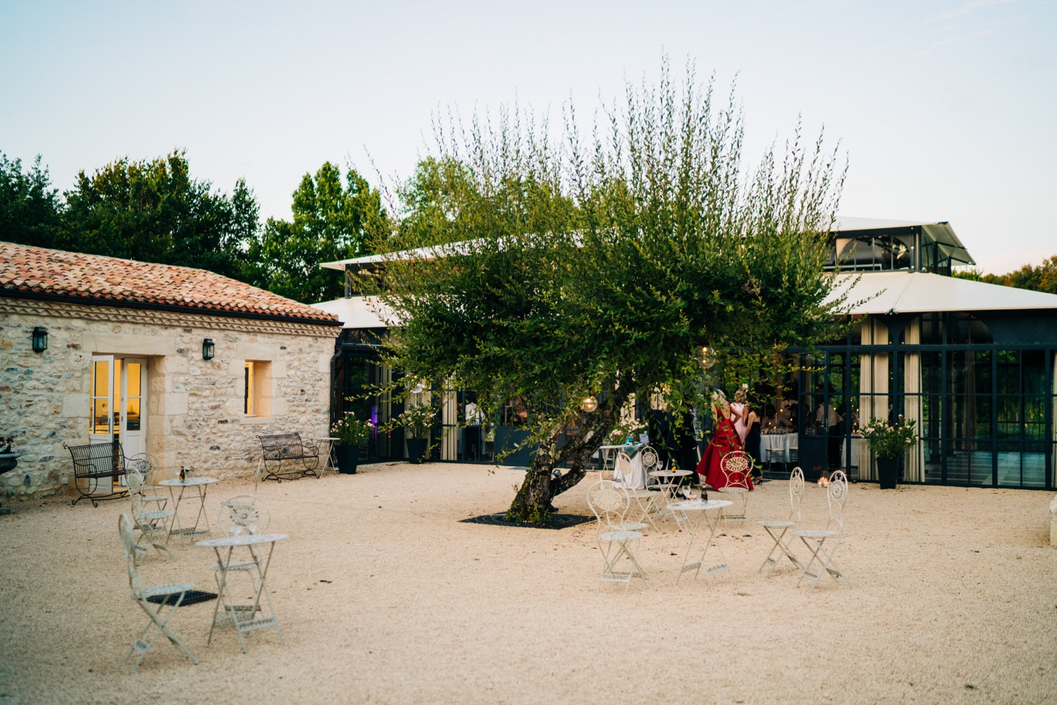 The courtyard of a beautiful wedding venue in Europe called Domaine La Fauconnie in France.